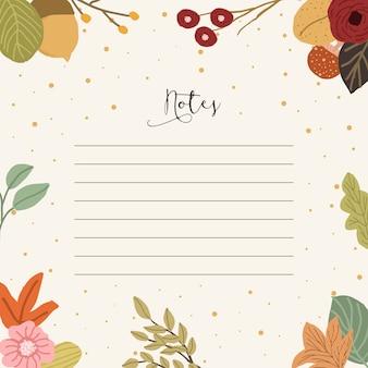 Notities met herfst bloemen achtergrond