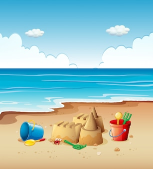 Oceaanscène met speelgoed op het strand