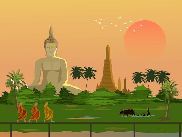 Ochtendsfeer op het platteland van thailand. drie monniken die aalmoezen maken. boeren ploegen met buffel. grote boeddha en pagode op de achtergrond