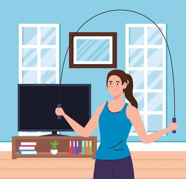 Oefening thuis, vrouw springtouw, het huis gebruiken als een sportschool