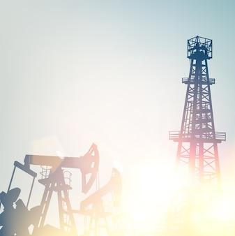 Oliepompen en boortorens over zonsondergang achtergrond.