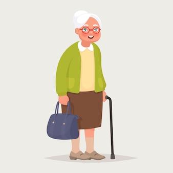 Oma draagt een bril. een oudere vrouw met een tas en een wandelstok in haar handen.