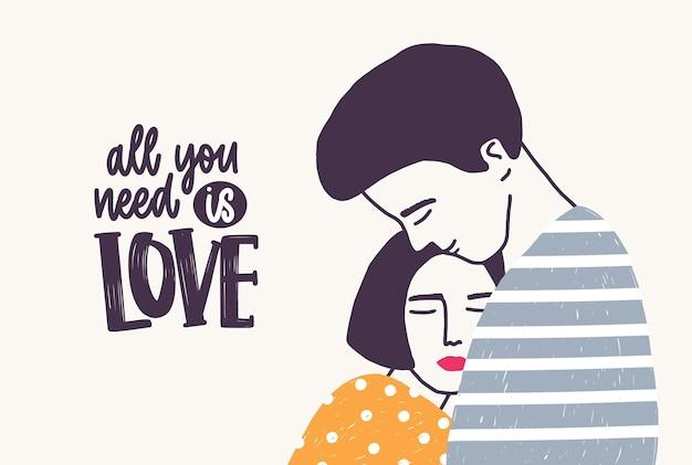 Omarmen jonge man en vrouw en alles wat je nodig hebt is liefde-belettering handgeschreven met elegant lettertype