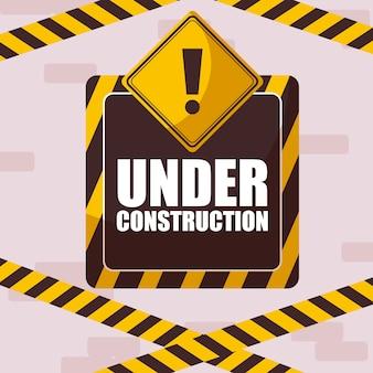 Onder constructie label met voorzichtigheidstape