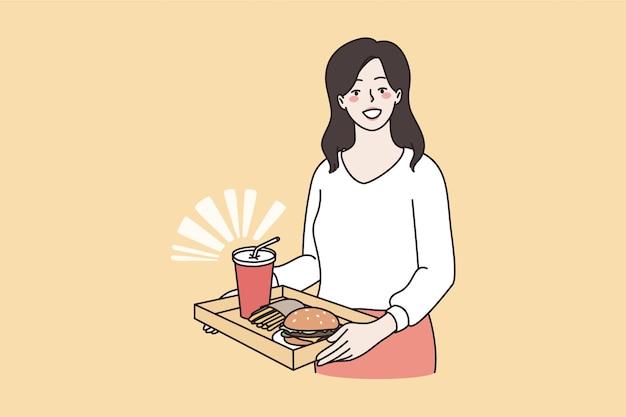 Ongezond eten en vet dieet concept. jonge lachende vrouw stripfiguur staande houden dienblad met hamburger en limonade drinken ongezond eten vectorillustratie