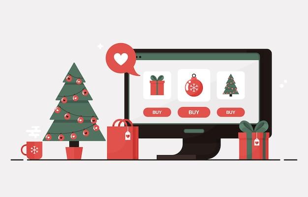 Online kerstinkopen op een computer met kerstboom, geschenkdozen, cadeautjes en decoraties voor winteruitverkoop