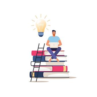 Online onderwijs of cursussen. jonge man met laptop zit op boeken. concept van afstandsonderwijs.