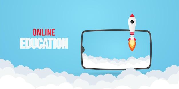 Online onderwijsconcept. telefoon met raket.