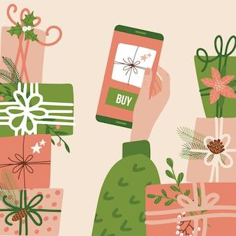 Online winkel-app voor de hand van de vrouw met kerstmis en nieuwjaar met de koopknop op de...