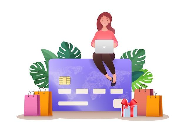 Online winkelen concept vectorillustratie met vrouw met behulp van laptop zittend op de top van een creditcard