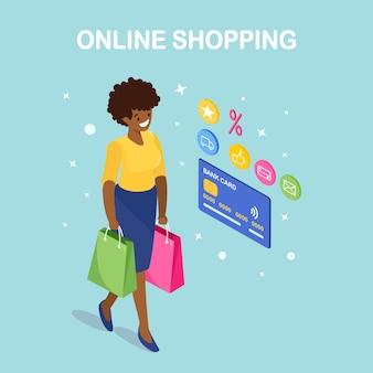 Online winkelen, verkoopconcept. koop in de winkel via internet. isometrische vrouw met tassen, creditcard, klantrecensie feedbackster