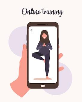 Online yoga en sport thuis concept. oefeningen doen met een mobiele app. blijf gezond en fit tijdens epidemie en quarantaine. vectorillustratie van arabische vrouw in hijab yoga onderwijzen via internet.