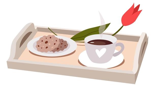 Ontbijt op houten dienblad met koffie, tulpen en haverkoekjes.