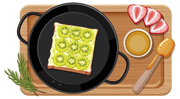 Ontbijtset in de pan met snijplank