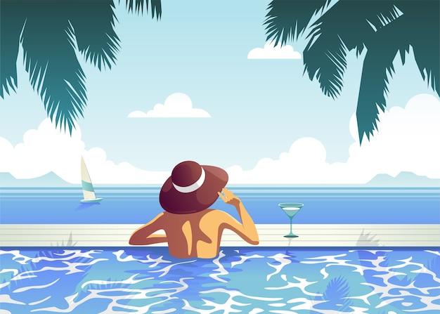 Ontspannen meisje in het zwembad, in een luxe hotel met een heldere doordeweekse dag naast elkaar, genietend van de perfecte strandvakantie.