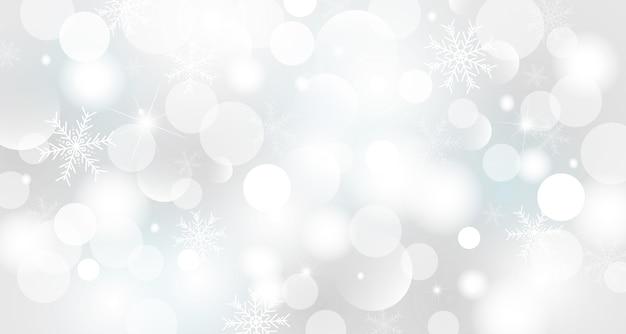 Ontwerp van de achtergrond van kerstmis en winter van bokeh lichten met sneeuwvlok