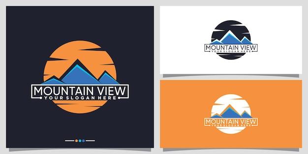 Ontwerpsjabloon voor logo met uitzicht op de bergen met creatief concept premium vector