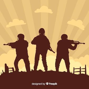 Oorlogsachtergrond met silhouetten van militairen