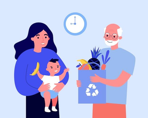 Opa die een zak fruit geeft aan nieuwe moeder en baby