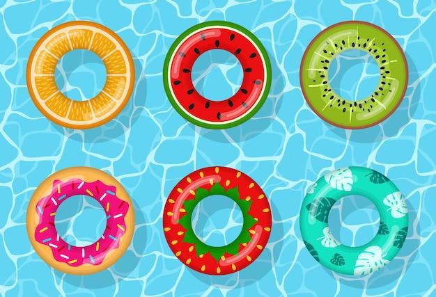 Opblaasbare zwemringen die eruitzien als sinaasappel, watermeloen, kiwi, donut, aardbei en tropisch op waterzwembad, rubberen dobber redder in nood, boei kinderen strand zomer zeewater thema. vector iconen