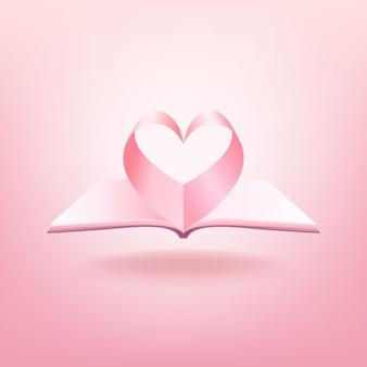 Open boek en vorm van hart geïsoleerd op roze
