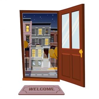 Open deur in de stad sterrennacht weergave herfst stad met gele bomen.