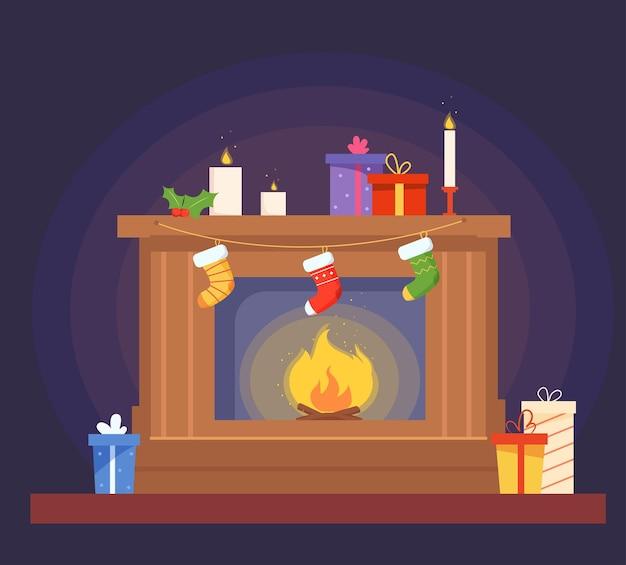 Open haard versierd voor kerstmis met hulstboom geschenken kaarsen sokken