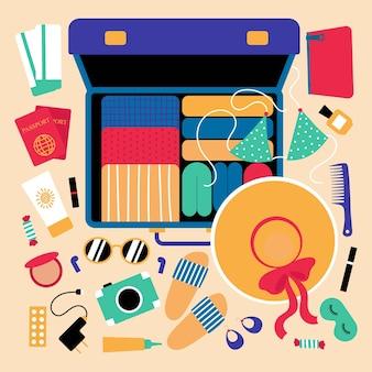 Open koffer met dingen voor op reistour of the seaeen set objecten voor op reis