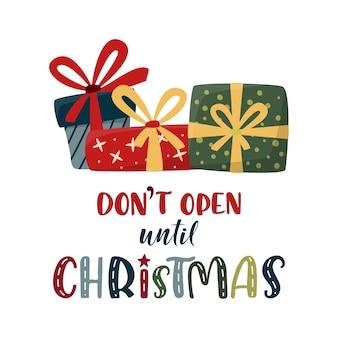 Open pas met kerstbelettering met kerstcadeaus. leuke kleurrijke tekst en geschenkdozen geïsoleerd op wit. xmas en nieuwjaar vector teken voor winter vakantie ontwerp.