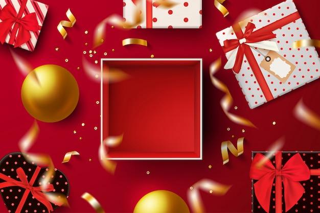 Open rode geschenkdoos bovenaanzicht op rood