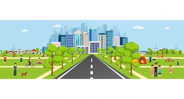 Openbaar park met een weg die leidt naar een moderne grote stad met wolkenkrabbers.