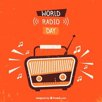 Oranje achtergrond met vintage radio wereld radio dag te vieren