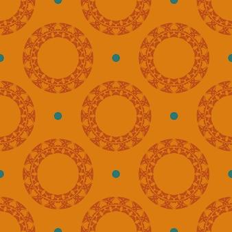 Oranje bedauwd naadloos patroon met vintage ornamenten. achtergrond in een vintage stijlsjabloon. indiase bloemenelement. grafisch ornament voor behang, verpakking, verpakking.