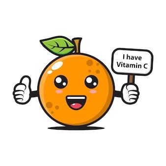 Oranje mascotte met een bord waarop staat dat ik vitamine c heb