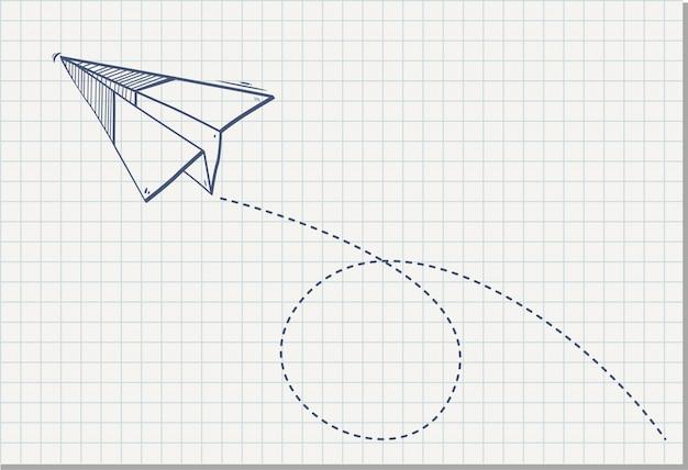 Origami papier vliegtuig op het vel van de notebook