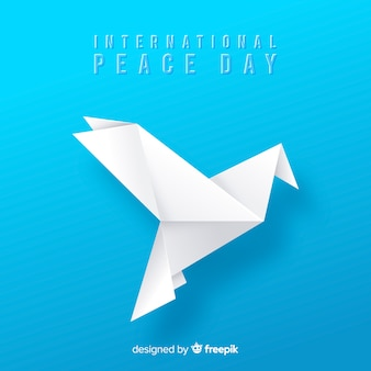 Origami vredesdag achtergrond met duif