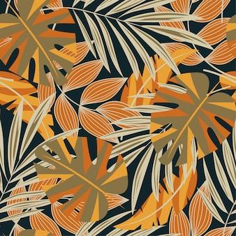 Origineel abstract naadloos patroon met kleurrijke tropische bladeren en planten op een donkere achtergrond