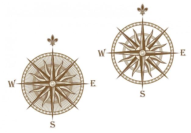 Oud kompas dat op witte achtergrond voor reisontwerp wordt geïsoleerd