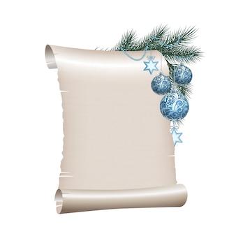Oud leeg roldocument met blauwe kerstmisballen op groene nette tak