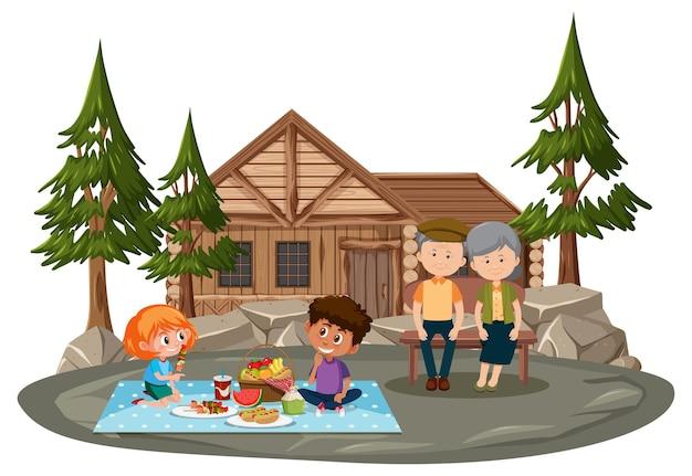 Oud stel picknickt in met veel kinderen het park geïsoleerd