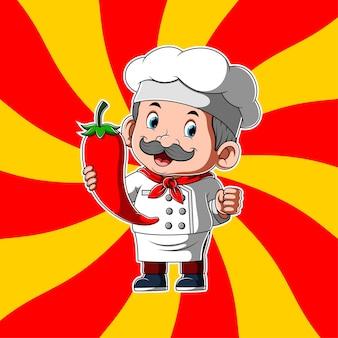 Oude chef-kok met grote rode kil in zijn handen
