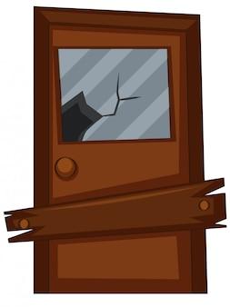 Oude deur met gebroken glas