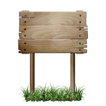 Oude houten bord in een gras.