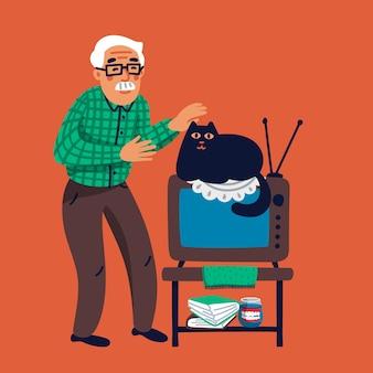 Oude man met zijn kat. grootvader die zijn zwarte kat aait die op tv ligt.