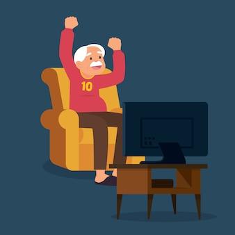 Oude man voetbal kijken op tv