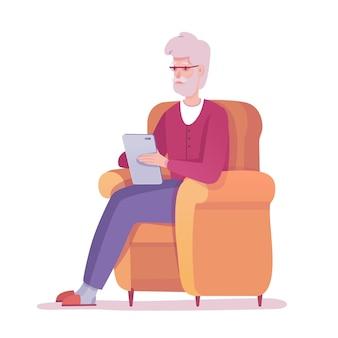 Oude senior man met digitale tablet
