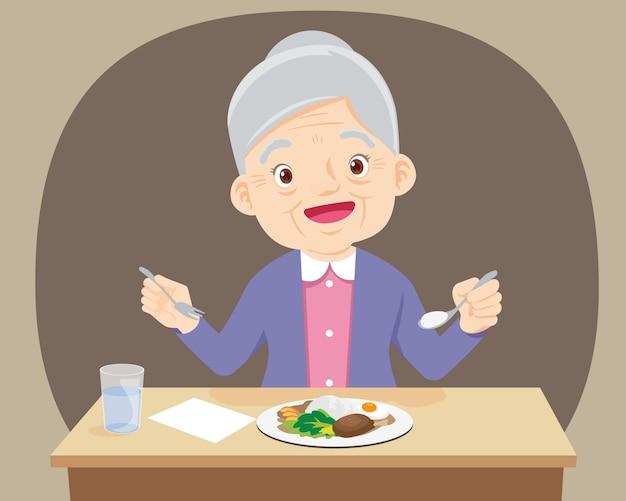 Oude senior vrouw gelukkig eten