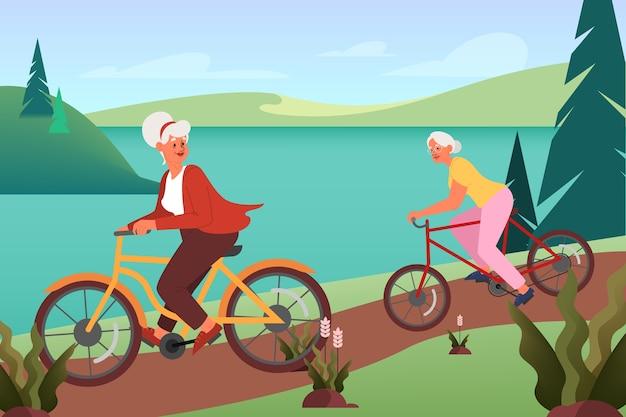 Oude vrouw die hun fiets in foret berijdt. actief buitenleven voor ouderen. grootmoeder fietsen buiten. zomer activiteit.