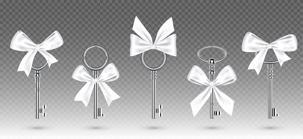 Oude zilveren sleutels met gebonden witte strik