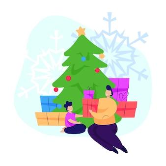 Ouder die kerstcadeau geeft aan kind